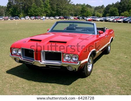 This is an early 1970s red convertable mussle car taken at a car show. - stock photo