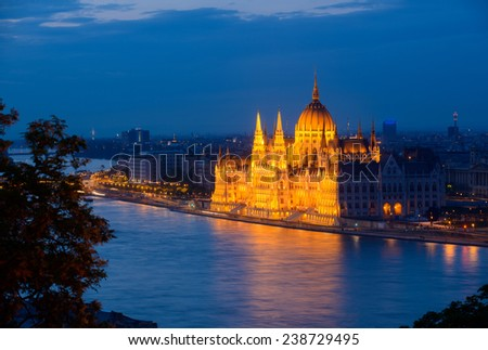 This is an evening view of Budapest (Hungary). Illuminated building of the parliament is the point of culmination in this composition.