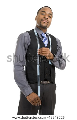This is an image of a business man using a measuring tape.