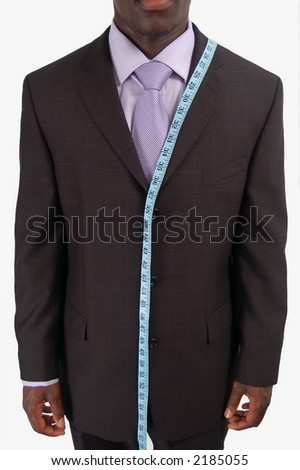 This is an image of a business man, wearing measuring tape. - stock photo