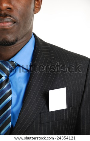 This is an image of a business man with a card inside the suit pocket. Designers can embed an image or writing on the card. - stock photo
