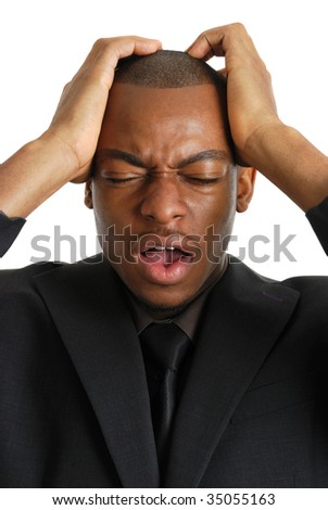 This is an image of a business man with his hands on his head, due to business failure.