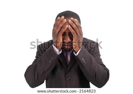 "This is an image of a business man with his hands to his head. This image can represent ""Bad news"", ""Poor Investment"", ""Confusion"" etc.. - stock photo"