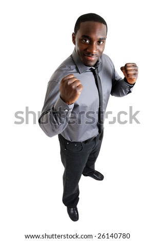 This is an image of a business man with his hands up in excitement. - stock photo
