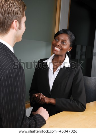 This is an image of a business team having a discussion. - stock photo