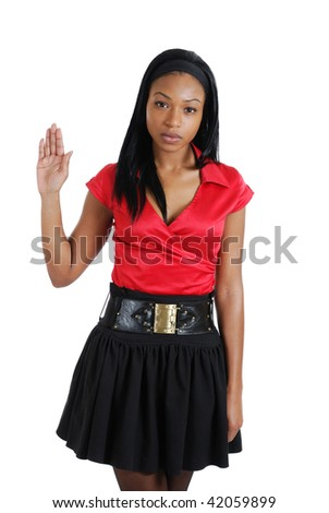 This is an image of a business woman with her hand raised. - stock photo