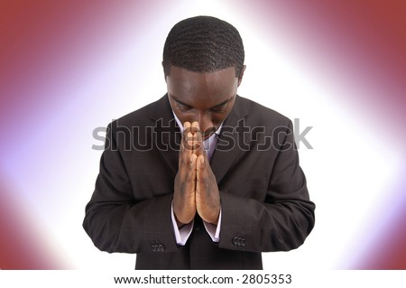 This is an image of a businessman focussing on prayer.