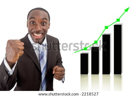 This is an image of a businessman fully excited due to a rise in profits, symbolised by the graph behind him. - stock photo