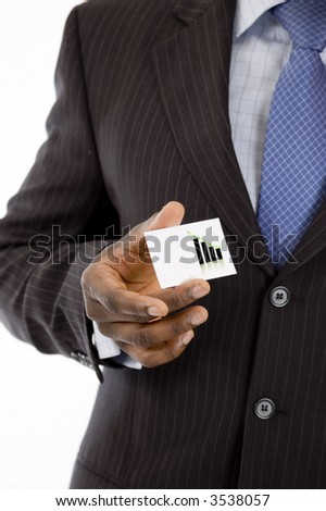 This is an image of a businessman holding a card.