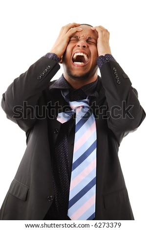 This is an image of a businessman with his hands to his head. - stock photo