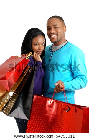 This is an image of a couple holding a shopping bag.