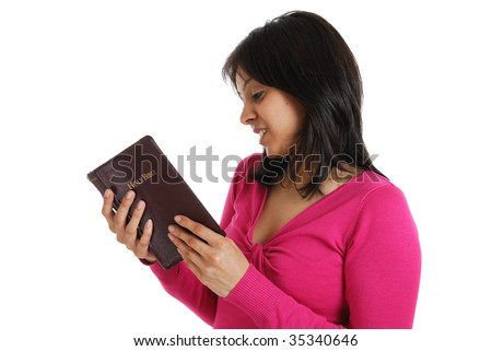 This is an image of a female student  reading a bible. - stock photo