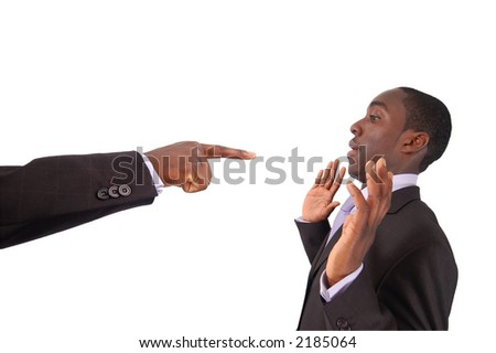 This is an image of a hand pointing at a businessman. This image can used to represent blame themes, accusation etc... - stock photo
