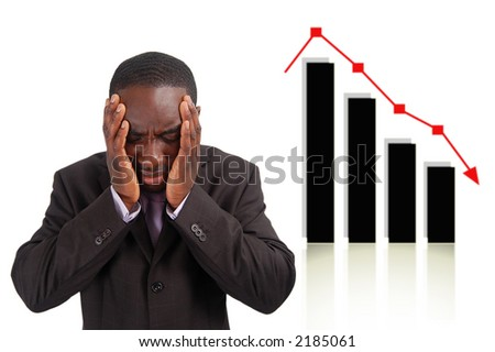 This is an image of a man deeply depressed due to a drop in the graph. This image can be used to represent stock losses, sales losses etc.. - stock photo
