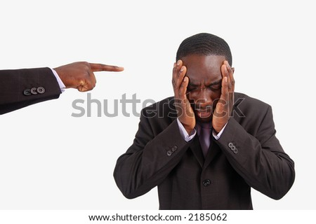 This is an image of a man feeling guilty, with a finger pointing at him. - stock photo