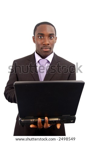 This is an image of a man holding a laptop. - stock photo