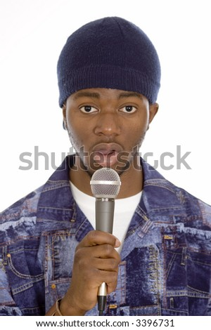 This is an image of a man holding a microphone. - stock photo