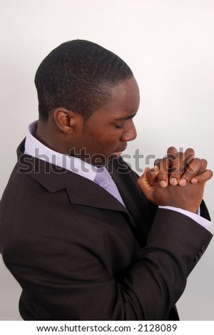 This is an image of a man on his knees praying - stock photo