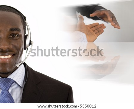 This is an image of a man with a microphone headset on, with conceptual handshake in the background. - stock photo