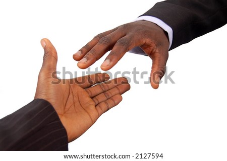 This is an image of a pair of black business hands reaching out to each other. Metaphor for contract agreement, business help, employment opportunities etc..