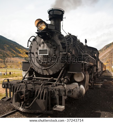 This is an image of a restored steam engine and train. - stock photo