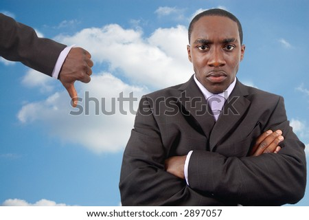 "This is an image of an angry businessman who is trying to manage his anger. The thumbs down is a sign of discouragement. This image can be used to represent ""Poor Anger Management"" themes - stock photo"
