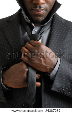 This is an image of business man dressing up and fixing his tie - stock photo