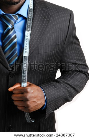 This is an image of business man wearing a tape measure across his suit. - stock photo