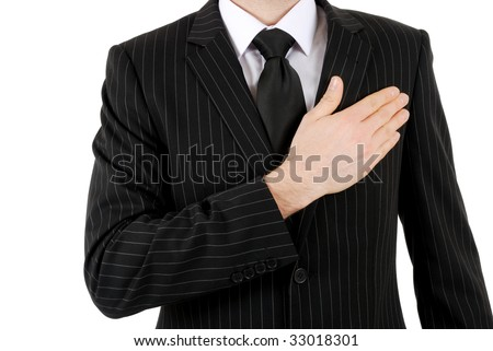 This is an image of business man with hand across his chest. - stock photo