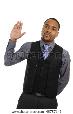 This is an image of business man with his hand raised. - stock photo