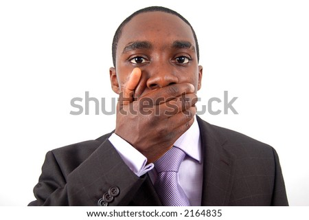 This is an image of businessman with his hands on his mouth. This posture implies trouble, danger, mistake etc.. - stock photo