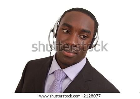 This is an image of close up of a man with a microphone headset on. This image can be used for telecommunication and service themes. - stock photo