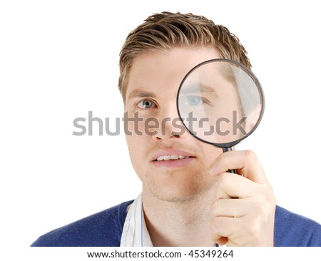 This is an image of male student looking through a magnifying glass.