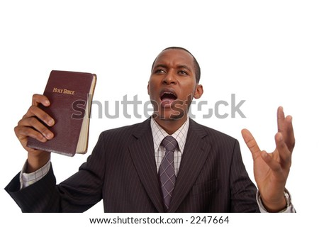 """This is an image of man holding a bible. This image can be used to represent """"sermon"""", """"preaching"""" etc... - stock photo"""