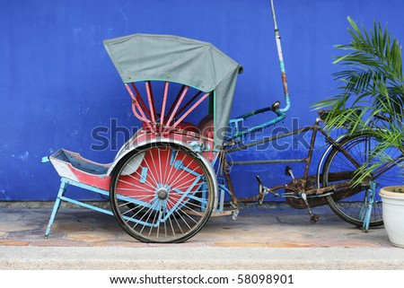 This is an old cycle rickshaw from Penang.  It's a classic symbol of old Penang and Asia. - stock photo