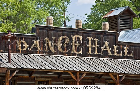 This is an old fashioned wild West type building that is a dance hall. - stock photo