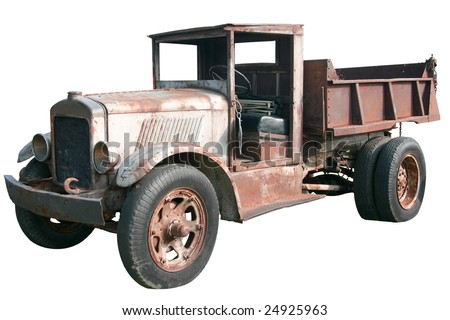 This is an old 1920s dump truck tipper in great disrepair, isolated on a white background.