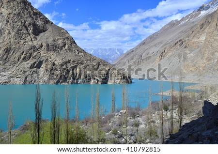 This is Attabad lake close to Hunza valley with blue color and foreground is poplar tree  locate in northern of Pakistan - stock photo