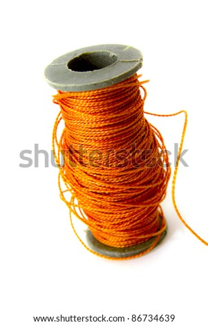 This is bobbin with thread . It is theme of dressmaking. - stock photo