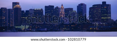 This is Boston Harbor and the skyline. It is the view from south Boston at dusk. - stock photo