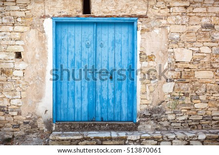This is close up of an old wooden blue door.