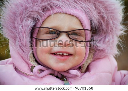 This is Closeup of funny baby in glasses