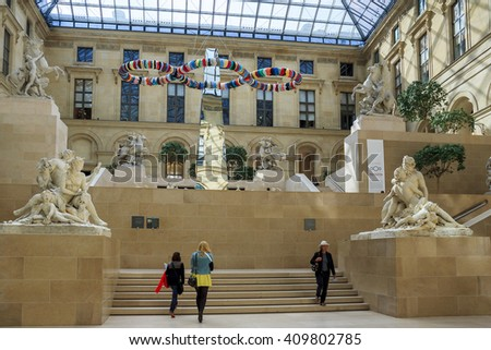 "This is courtyard of the Louvre glass-covered and named in honor of Marley's Court a unique sculptural group Guillaume Coustou ""Horse Tamers"" May 12, 2013 in Paris, France. - stock photo"