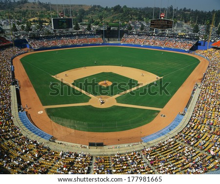 This is Dodger Stadium. This game was played by the LA Dodgers and the Houston Astros. The attendance at this game was 42, 264. The Dodgers won with a score of 5 to 1. - stock photo