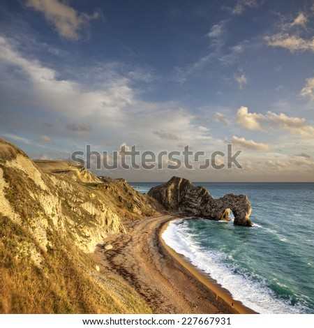 This is Durdle Door, a natural arch of Portland Stone on the Jurassic Coast World Heritage Site in Dorset, England.  - stock photo