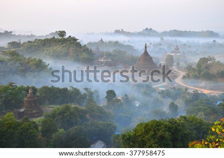 This is famous one of beautiful Mrauk-U pagoda in Myanmar with mist in evening time  - stock photo