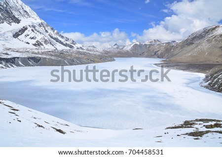 This is frozen Tilicho lake with snow ice  in May along Annapurna circuit trekking , Manang , Nepal