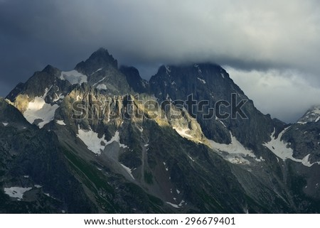This is gloomy summit in Caucasus mountains in evening - stock photo
