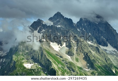 This is gloomy summit in Caucasus mountains in summer - stock photo