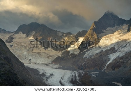 This is gloomy sunrise in Caucasus mountains in summer - stock photo